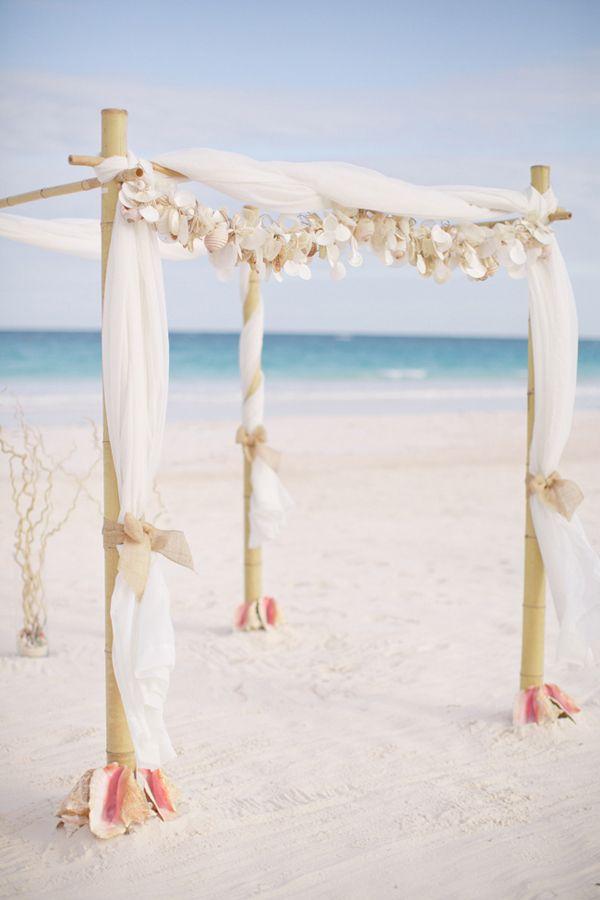 Love this tropical beach wedding arch!