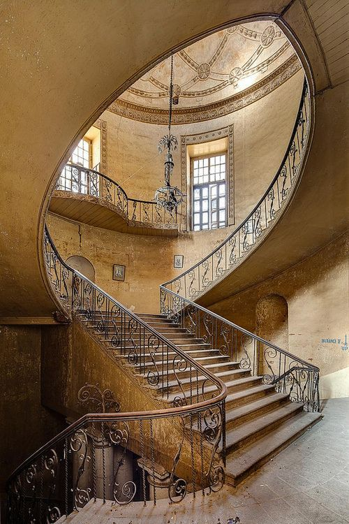 Staircase of the abandoned British Residency in Hyderabad, India. Such a beautiful stairway.
