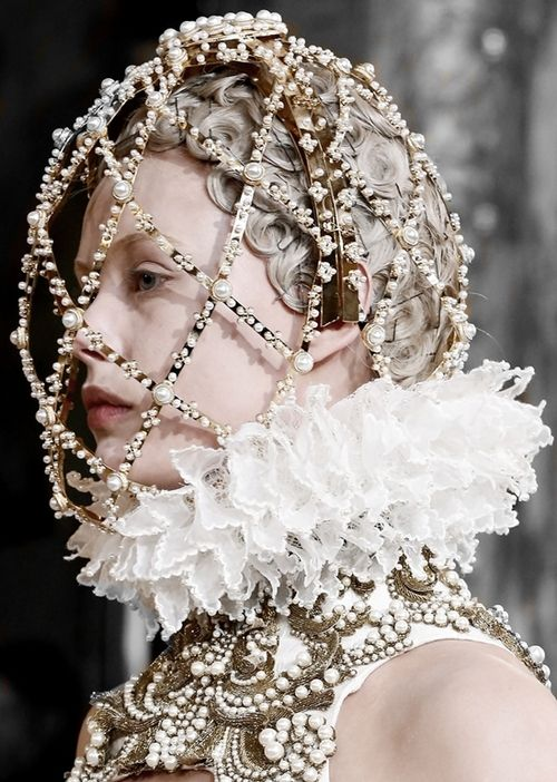 Frida Gustavsson walking Alexander McQueen FW 2013 by Sarah Burton, her hair is in a modern day snood.