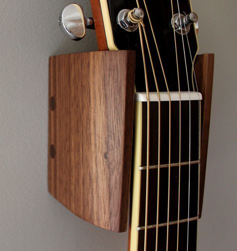 I made these guitar hangers out of black walnut.  It's a pretty simple DIY project easily completed in one weekend. These guitar hangers are designed for my son's Yamaha acoustic guitars but the measurements could easily be adjusted to fit most guitars simply by changing the width of the back piece. This is one of those projects where it's good …