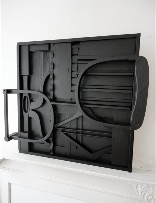 Black Louise Nevelson Style wall sculpture - mid century art, via Etsy.