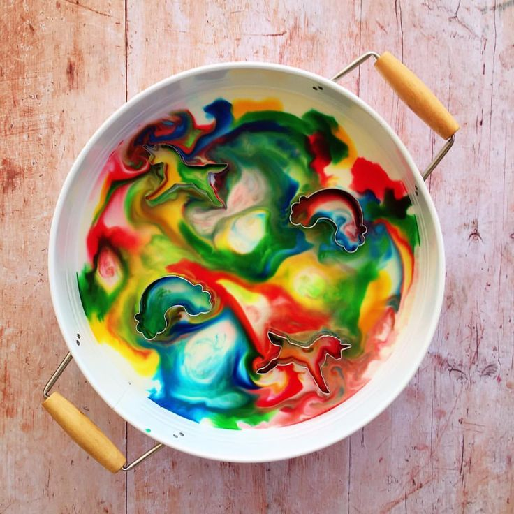 Unicorn and rainbow magic milk. Just pour some milk into a tray, scatter it with drops of food colouring, then touch the colours with a cotton bud dipped in dishwashing detergent and watch the colours burst and swirl! Adding the cookie cutters is fun because you can separate the colours inside and out.