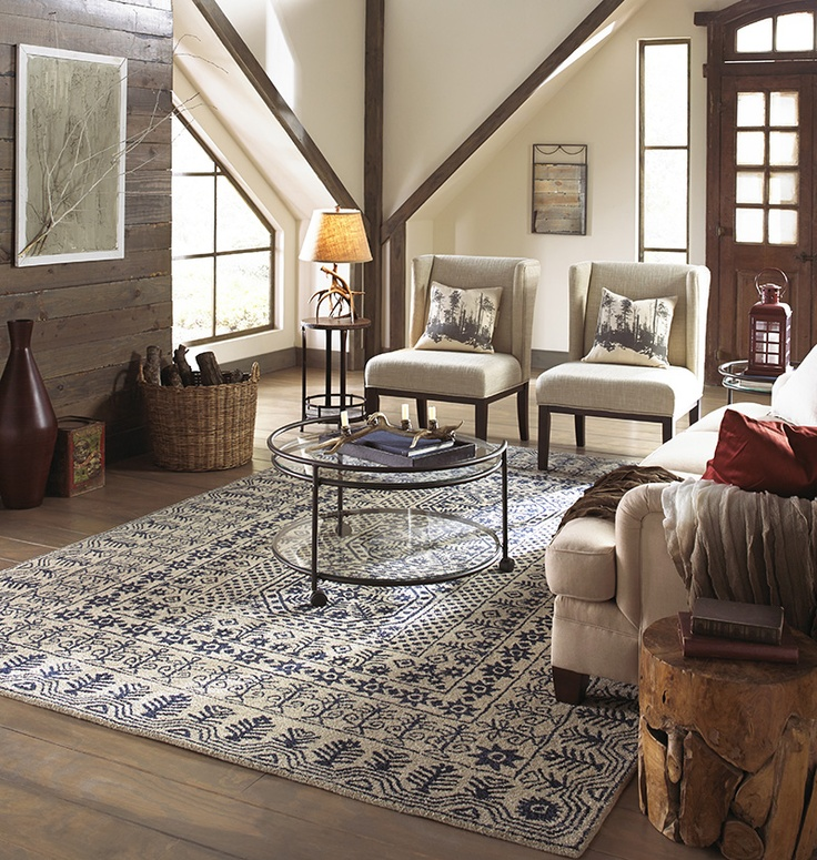 Intricate Patterned Blue And Ivory Hand Tufted Rug From Suryas Smithsonian Collection SMI Traditional Living RoomsInterior