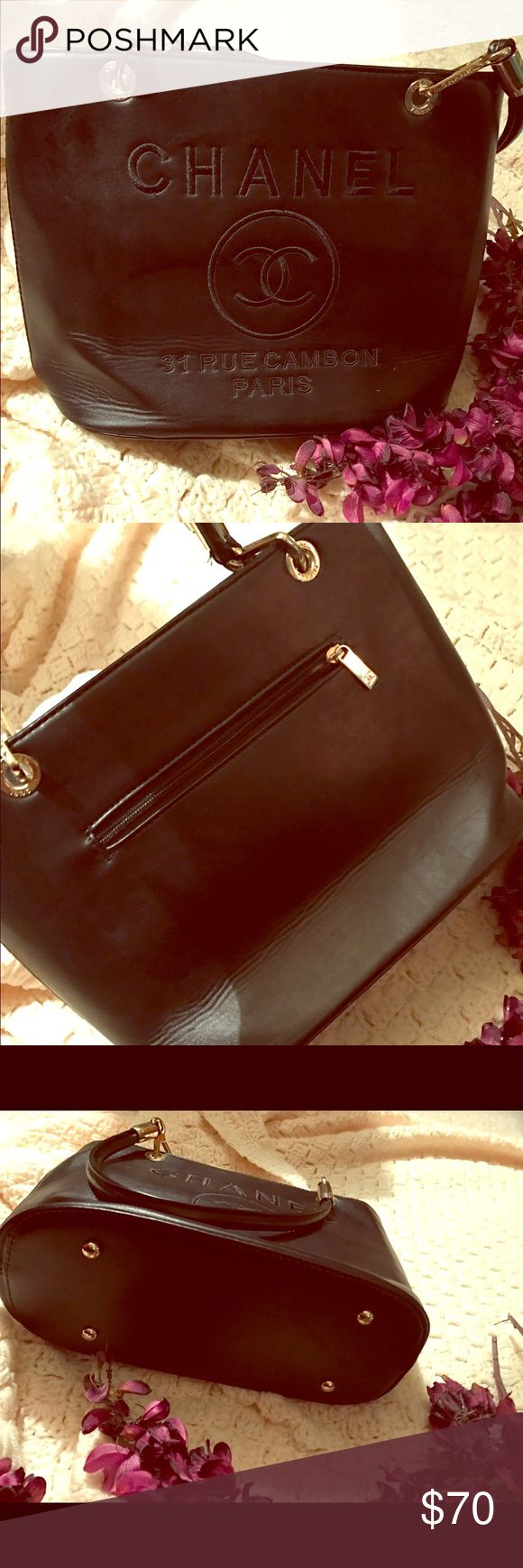 """❗SALE❗NO BRAND (CHANEL) Purse⭐ This pre-loved bag was bought from another posher! In perfect condition no tearing or stains on exterior or tears on the interior! Had two slip pockets and one zipper enclosure. The top zips shut! 😍 I just like a big bag!! Only reason why I'm looking to re-sell 🙂 14"""" W x 9.5"""" Tall x 5"""" Deep. 9.5"""" drop handles. Price says the obvious! Thank you for stopping by ❤ Bags Shoulder Bags"""