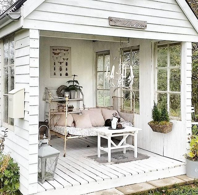 tongue twister shabby chic she shed elongated front porch with salvaged windows