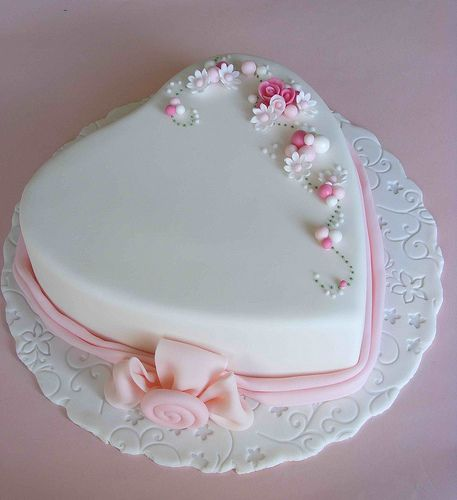 White heart cake with dainty flowers