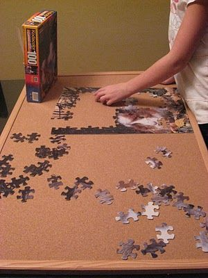 use a cork bulletin board to make puzzles portable. Brilliant. And it slides right under the kids' beds (or the couch) when it's time to clean up and the puzzle's still a work in progress. Pinterest comes through with another cheap solution!