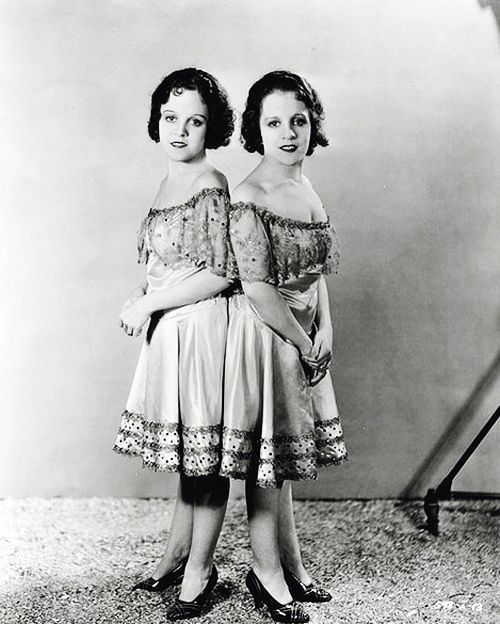 someghostsarewomen, vintagegal:  Conjoined twins Daisy and Violet Hilton on the set of Tod Browning's Freaks (1932)