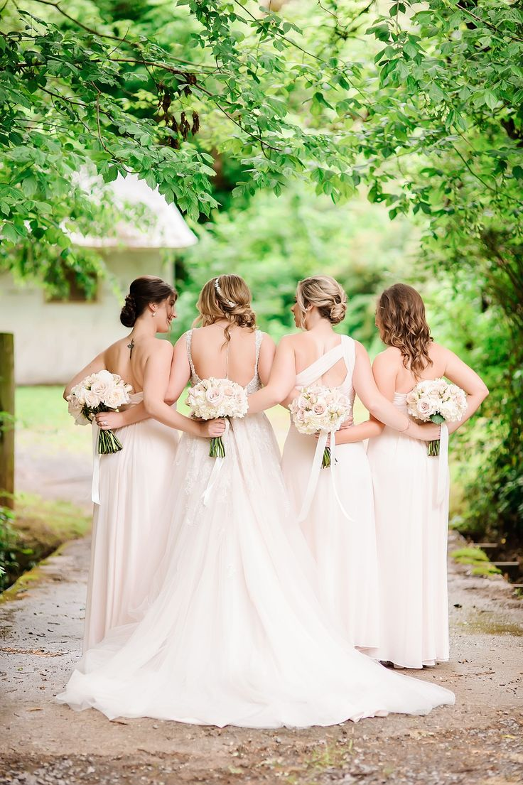 Pale pink bridesmaids dresses in different styles.   Garden Romance with Tracy Shoopman Photography