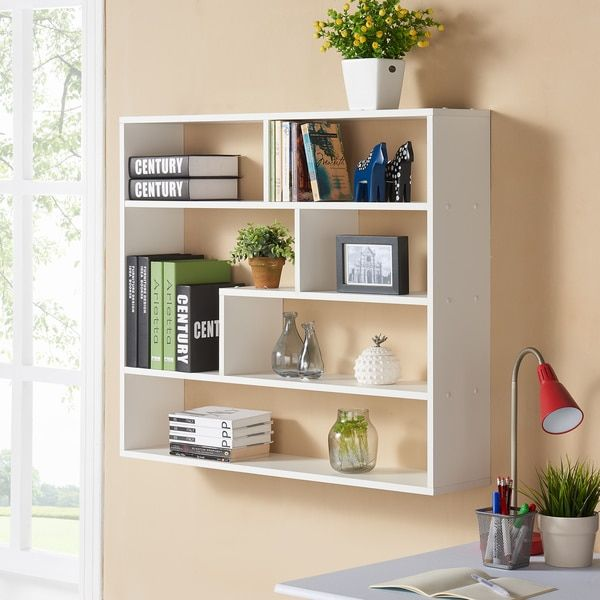 Showcase family portraits, books, or eye-catching dcor on this casual Danya B Large Rectangular White Shelf Unit which features clean lines and a streamlined design. Six divided open shelves offer a g
