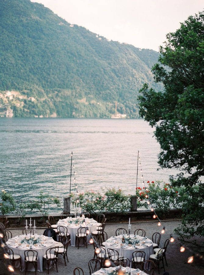 Elegant wedding reception overlooking Lake Como, Italy: http://www.stylemepretty.com/2016/11/23/a-lake-como-wedding-planned-abroad/ Photography: Darya Kamalova - http://www.thecablookfotolab.com/