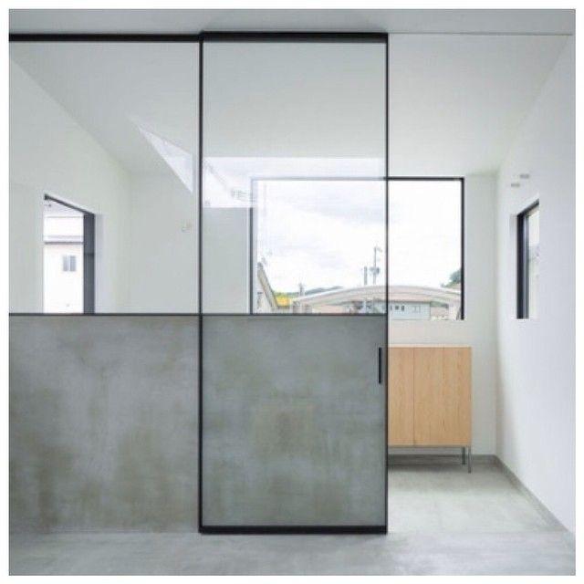 Entryway w/ black metal framed glass door. Design • Yasunari Tsukada   #entryway #interior #design #metal #modern #minimal #minimalism #minimalist #minimaldesign #concrete #concretefloor #concretewall #whitewall #glassdoor #sideboard #bright #light