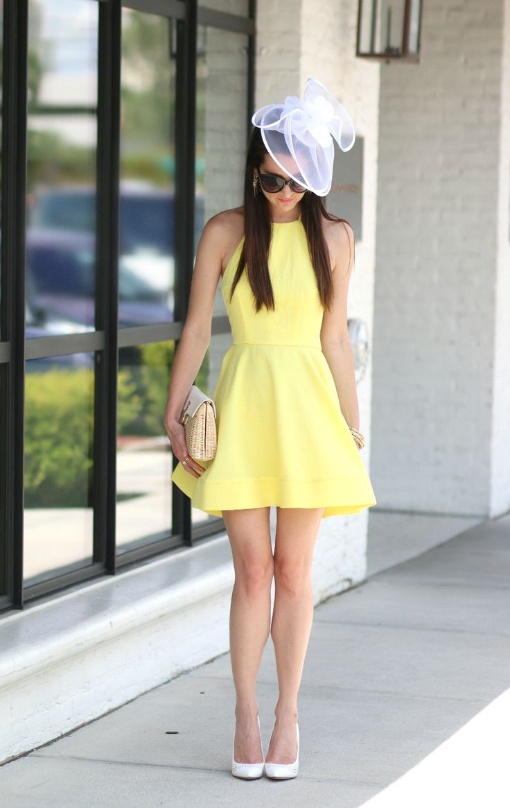 Buttercup yellow Derby dress from the Mint Julep Boutique with a bright white fascinator hat. Kentucky Derby perfection.