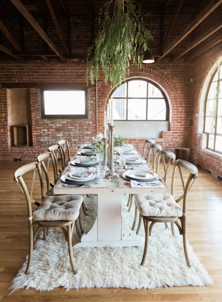 The natural brick walls, exposed wood beams, and amazing original window frames provided by Howl Event Space completed the earthy and elegant atmosphere. We gave the space some life by adding greenery to the ceiling beams and windows, allowing it to become a native extension of the building.CreditsPhotographers: Brian LaBrada PhotographyCoordinators & Stylists: Danielle Mitchell EventsVenues & Officiants: Howl Event SpacePaper Goods & Calligraphy: Ink Paper and JoyFlowers: Studio La…
