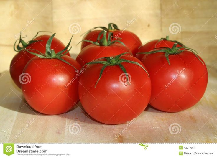 Some tomatoes on a desk