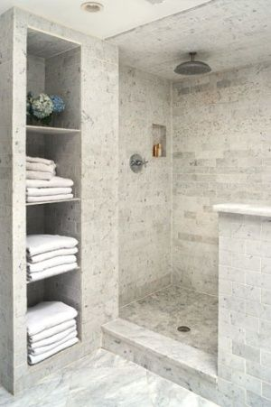 tile shower and niche for linen closet...like this shelf idea. Id give up closet space for it.