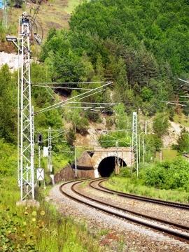 Summer view of railroad tracks and tunnel near Sutovo village, Slovakia.