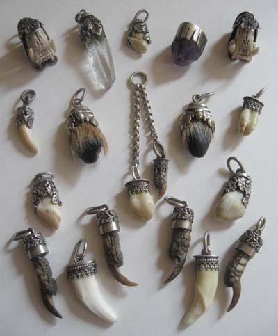 Antique charms, teeth, claws, bones