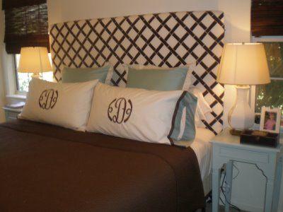 Monogrammed pillows and DIY fabric headboard