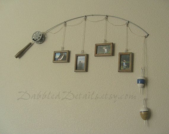 Nice idea.  Fishing Pole Picture Frame  Metal Silver  4 by DabbledDetails, $47.00