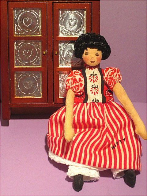 Barb's original Hitty doll and her wooden pie safe.  Pie safe opens to expose shelving.  You get both for $124.99 plus $10. for shipping and insurance.  May be purchased at http://barbspencerdolls.com