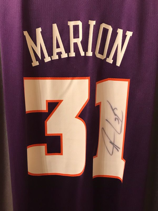 Signed Shawn Marion Jersey with Authenticity tag and never opened Bobblehead.