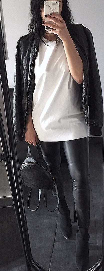 #spring #outfits woman wearing lack leather jacket and white crew-neck top taking picture on mirror. Pic by @unconceptmode