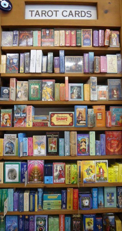Awesome display of a wide variety of tarot decks.  Wish this was in my living room!
