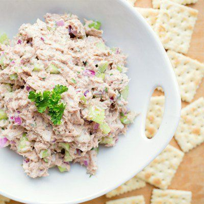 Try our skinny tuna salad! We use Greek yogurt instead of globs of mayo to cut back on calories. In fact, half a cup of this tuna salad is only 85 calories!