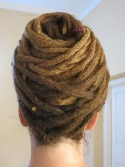 """3-5 year old dreads up do"" -- I've never understood dreads anyway, but this just looks like crap!"
