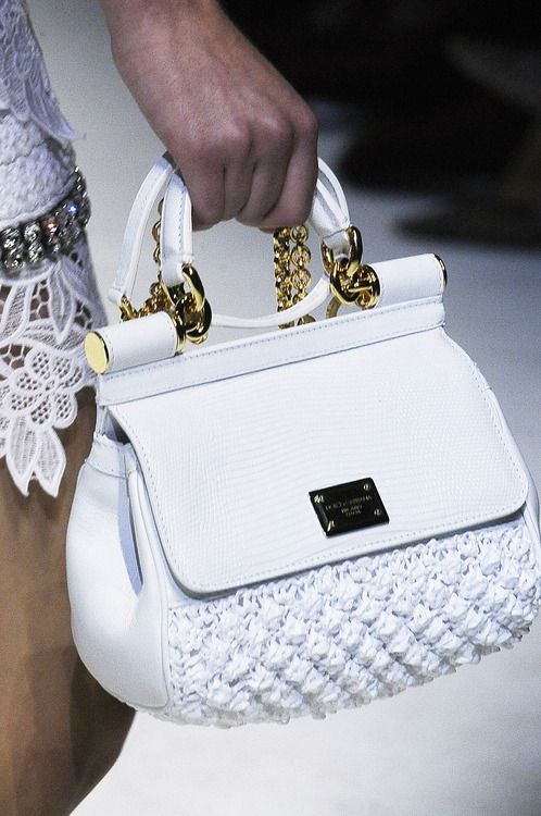 Dolce & Gabbana-It's White!  Keep it clean forever by hanging it everywhere you go. Use a purse hook from Hook-Her. www.hook-her.ca