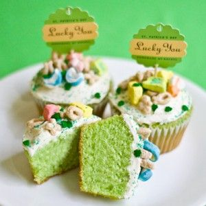 "Lucky You St. Patrick's Day Cupcakes.  Betty Crocker recipe with cupcake batter tinted green & Lucky Charms cereal topping.  Love the ""Lucky You"" cupcake toppers."