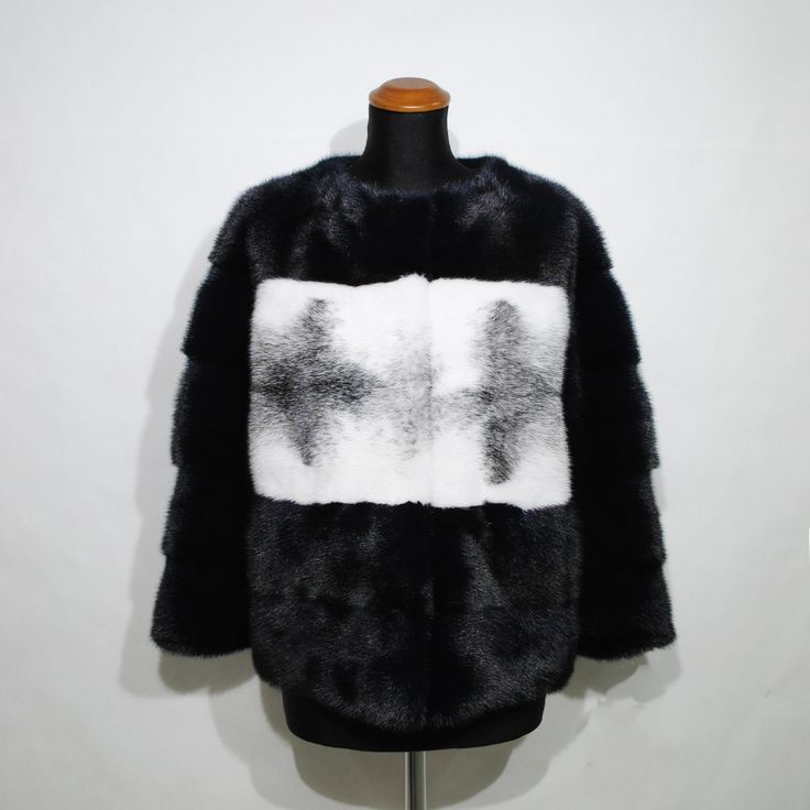 Discover the latest trends of fur outwear, like this stylish blue/black & grey mink fur jacket.