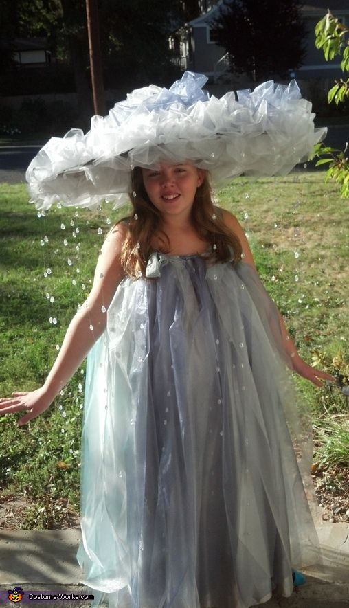 Tracy: This is my 11 year old dressed as a rain cloud. Her dress is actually the skirt portion of an adult's gown, I found in the second hand store, made...