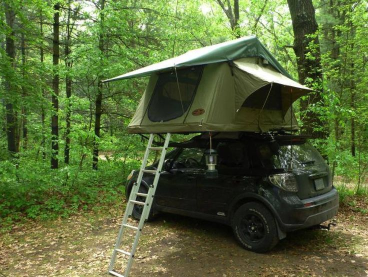 Nice compact camping set up, a customers Tent Topped Suzuki SX4