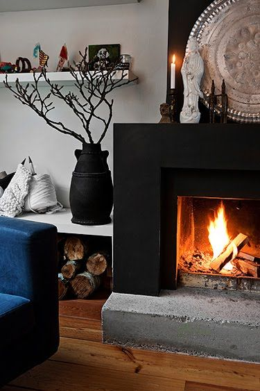 contrasting concrete elements in the fireplace. . . LOVE IT!