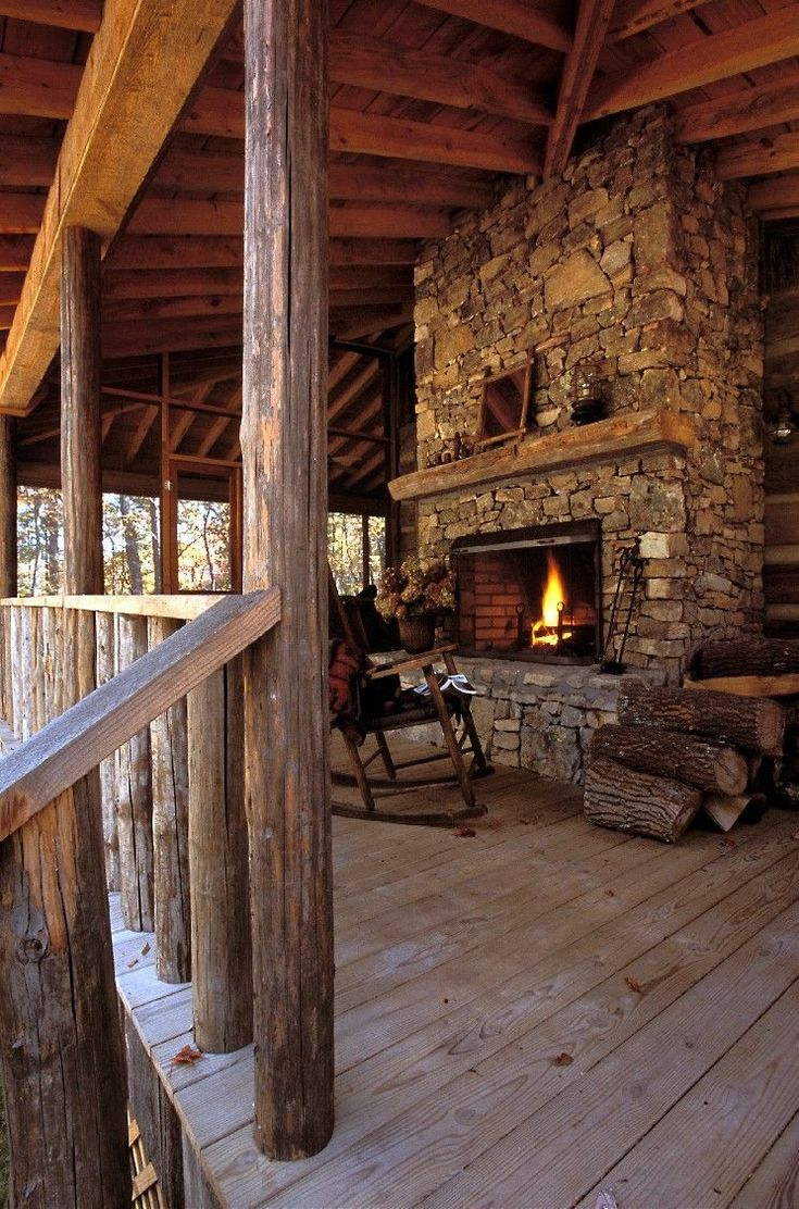 "Gorgeous fireplace on the back porch!  //  MAYBE THE ""MIRROR"" WOULD LOOK GOOD HERE?!  A #LogCabinHomes"