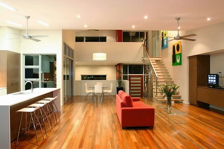Rich timber warms a room's décor. Simple furniture, smart lighting,  neat geometry field a cosy, open simplicity. www.davidreidhomes.com.au