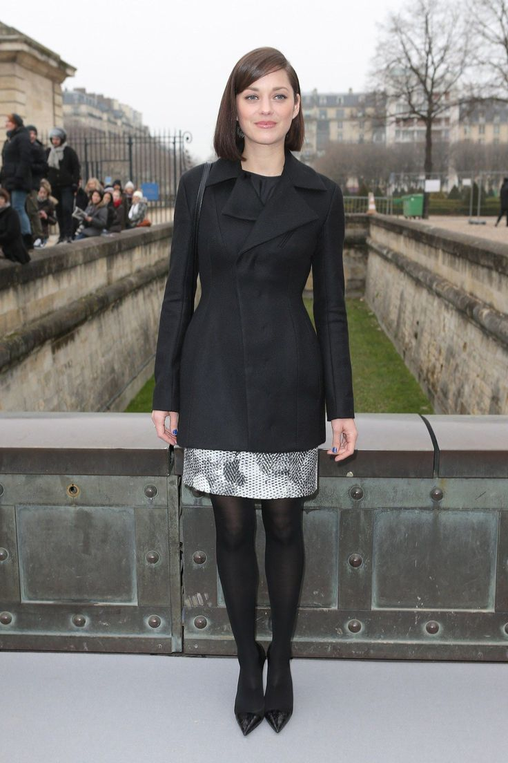 She arrived to the Christian Dior show wearing a coat from the spring/summer 2013 collection with a printed skirt, black opaque tights and classic court shoes.