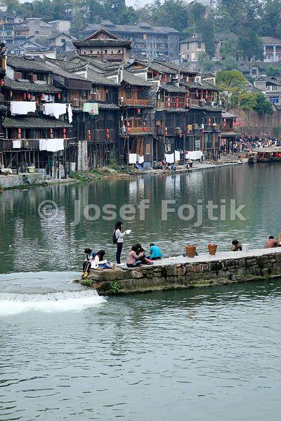 Young painter at the Tuo Jinag River, Fenghuang Town, Hunan, China