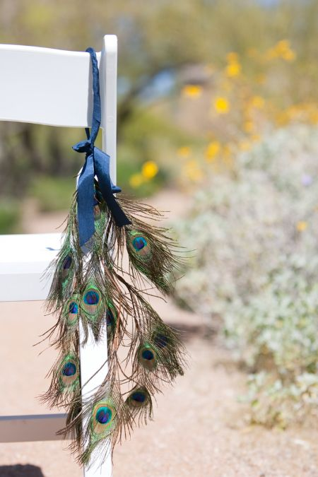 peacock feather arrangements | The stylist suggests marking the inside of your ceremony aisle with ...