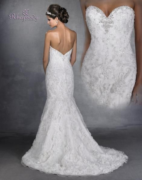 R6903  Sophisticated sheath with a trumpeting skirt embellished throughout with soutache ribbon over gracefully beaded and crystal embroidery. Fine netting over satin with outstanding ruffled flowers made of organza throughout the skirt with chapel train by Symphony Bridal