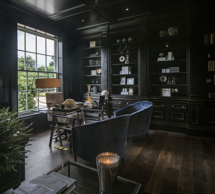 The dark organic tones of the furniture and solid wood flooring add warmth and intensity to our classic interior design of this magnificent study.