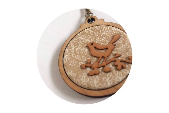 Maple Plywood circle pendant with fabric inlay and timber veneer bird detail