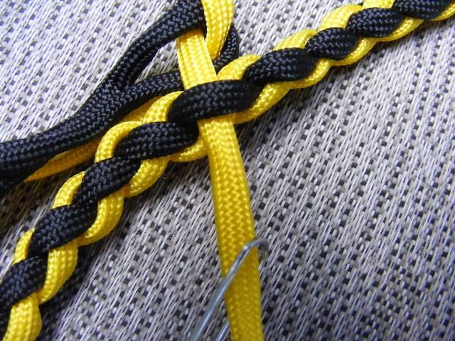Take each loose strand and splice into the leash 3 or 4 times.  Weave these strands in and neatly follow the pattern of the existing braid.