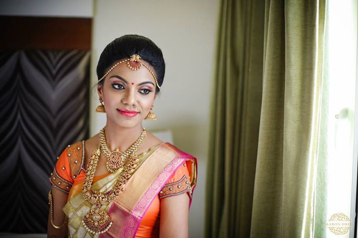 South Indian bride. Temple jewelry. Jhumkis. Pink and white silk kanchipuram sari.Braid with fresh jasmine flowers. Tamil bride. Telugu bride. Kannada bride. Hindu bride. Malayalee bride.Kerala bride.South Indian wedding.