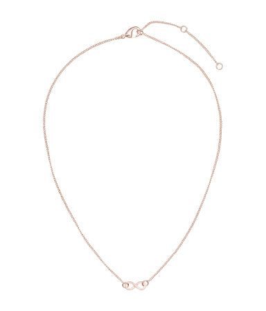 Short necklace with a small metal pendant. Adjustable length, 38-44 cm.