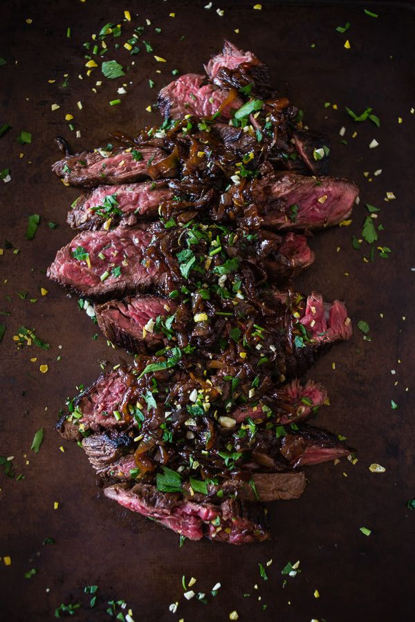This Newcastle brown ale marinated hanger steak is the perfect holiday meal. Perfectly cooked and topped with Newcastle caramelized onions. You need this!