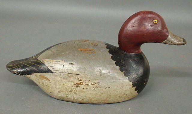 "Sold $475 Mason premier grade redhead duck decoy with yellow glass eyes. 6.25""h.x14""l.x5.5""w."