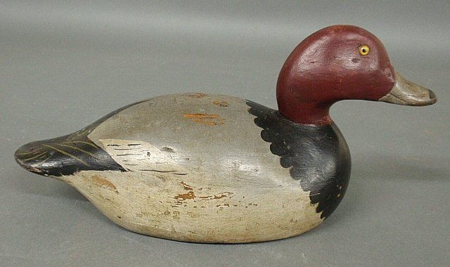 "Sold $475 Mason premier grade redhead duck decoy with yellow glass eyes. 6.25""h.x14""l.x5.5""w."
